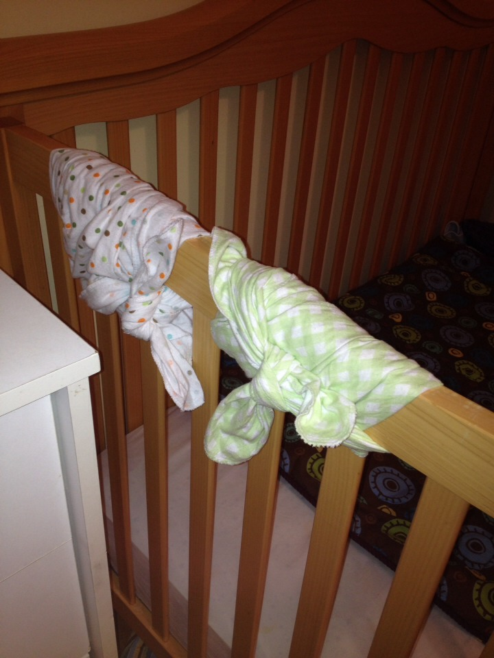 My one year old was chewing the heck out of the top of his crib rail. I got creative... And bam! I tied a couple of old receiving blankets around the railing! This way, he can still chew (teething), the crib won't turn to wood chips, and they can be removed for washing!