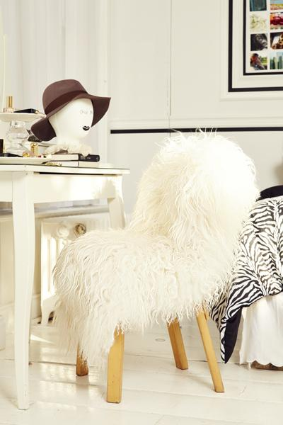 12. Faux-Fur Chair Daaahling, a faux-fur chair looks extravagent and feels cozy! Pick up sheepskin-like fabric at a discount home store or fabric shop and drape it over your chair. Voilà!