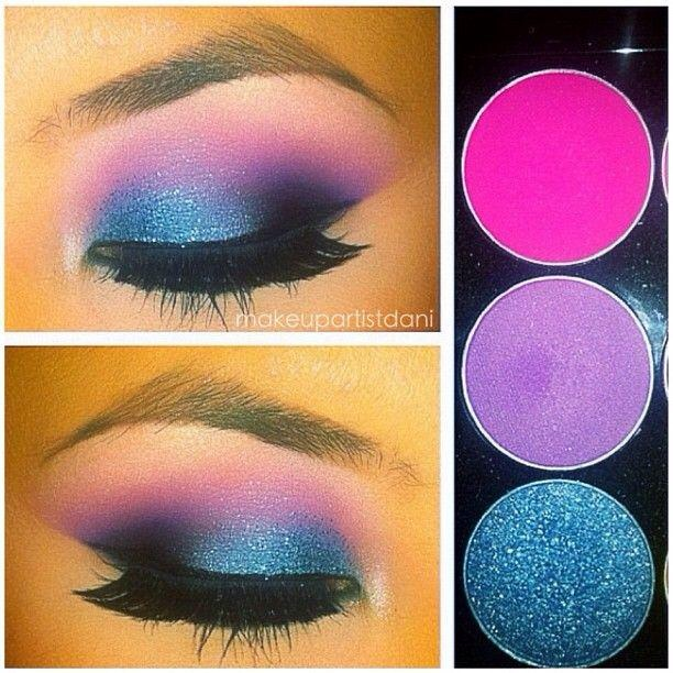 Pink in crease purple in V, Black in inner part of V and blend well, Blue on middle/inner lid, blue glitter over the blue shadow.