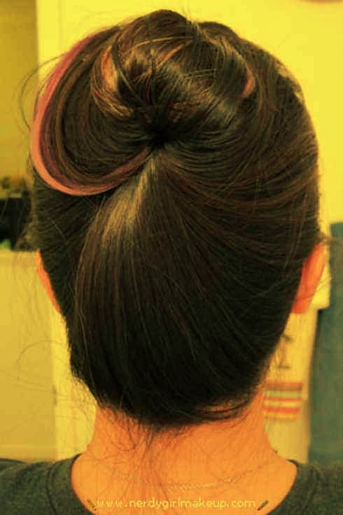 9. Create a bun without hairties, bobby pins, clips, or pencils.  It entails twisting your hair into a bun, lifting up a bit of hair from the side, and tucking the bun under.