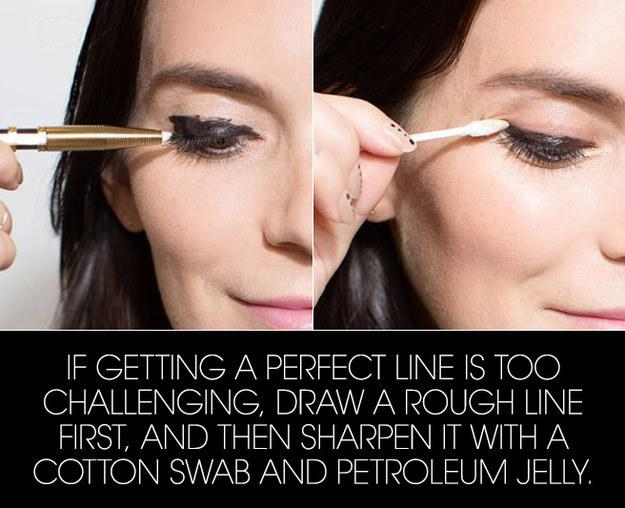 8. Start by drawing a messy line, then clean it up with a little petroleum jelly.  To avoid globs of jelly on ur eyelid, wipe the swab on the back of ur hand after dipping it in. (u will probably need a little help from makeup remover pre-jelly if u accidentally cover ur entire lid with eyeliner.)