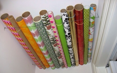 Gift wrap keeper. I already do this! Works great! Right inside the door of hall closet.