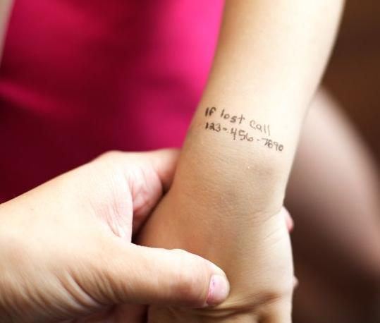 """Write: """"If lost, call (insert cellphone #)"""" on child's arm."""