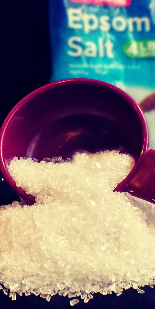 In a cereal sized bowl, mix 2 tablespoons of Epsom salt with a cup to a cup and a half  of luke warm water! Stir until the salt is completely dissolved in the water and you no longer see it.