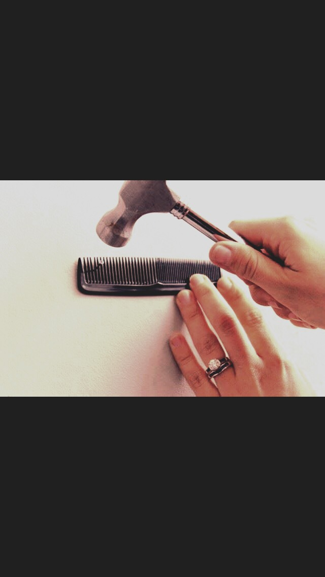 Use a comb to hold a nail in place without mashing your fingers