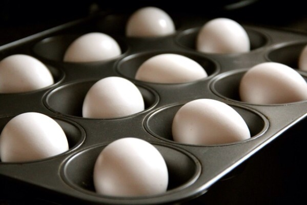 No water necessary. Place the eggs in a muffin tin in an oven heated to 350 degrees for 30 minutes. Next dip the eggs in ice water and they will peel perfectly.
