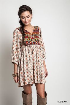 short bold print boho dress pair it with over the knee boots and a fur vest. top with a fun bowler hat.