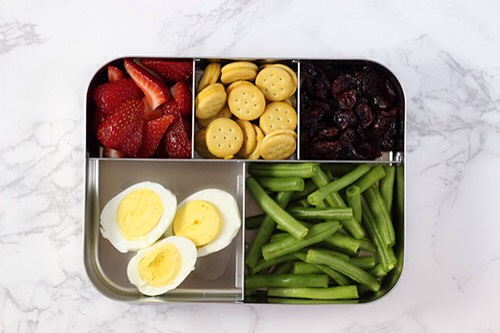 5 | Hard-Boiled Egg Lunch Combo My kids love hard boiled eggs.They are fun to eat and full of nutrients! If your child is adventurous you can pack their favorite hot sauce for dipping!  1. Hard boiled eggs 2. Green beans 3. Strawberries 4. Mini sandwich crackers 5. Dried cranberries
