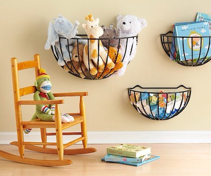 Garden baskets attached to a wall make perfect toy and book storage. Hang them at different heights to fit your child needs.
