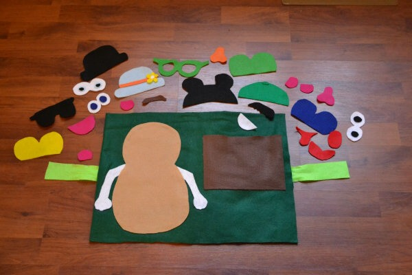 I did my best to create an assortment of items for Kyle to use to decorate his Mr. Potato Head.  I wish I could say that I have a pattern for you to follow if you wanted to make one of your own.  I don't.  I create most of my designs freehand.  I also created a pocket for Kyle to store all of it!