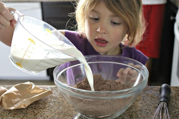 Begin by having your child whisk together the chocolate pudding mix and the milk.