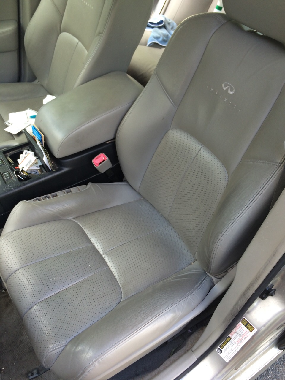 BEFORE- 2005 Infiniti with a fairly clean interior for the age