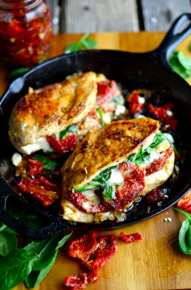 Follow this recipe for sun fried tomato, spinach, and cheese stuffed chicken!
