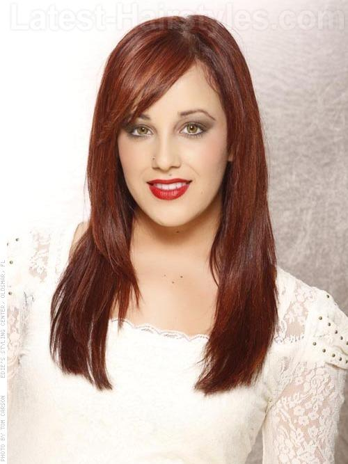 SEEING RED Hair that falls past the shoulders in a fiery hue looks gorgeous with just the right amount of layering and side swept bangs. The bangs are cut right at eye level with layers starting right around the shoulders and blending down