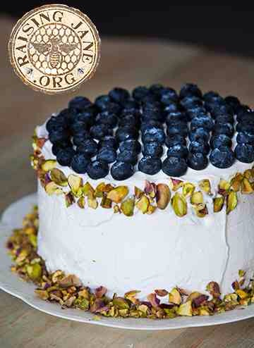 Garnish with remaining ½ cup shelled and chopped pistachios and ½ cup blueberries. Chill for 2 hours before serving.