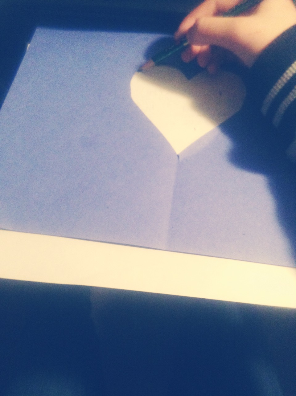 Cut out a heart shape on one piece of paper. Use that as a tracer and place on another paper. Write something cute and special, take off the first layer and viola!... A cute note in the shape of a heart