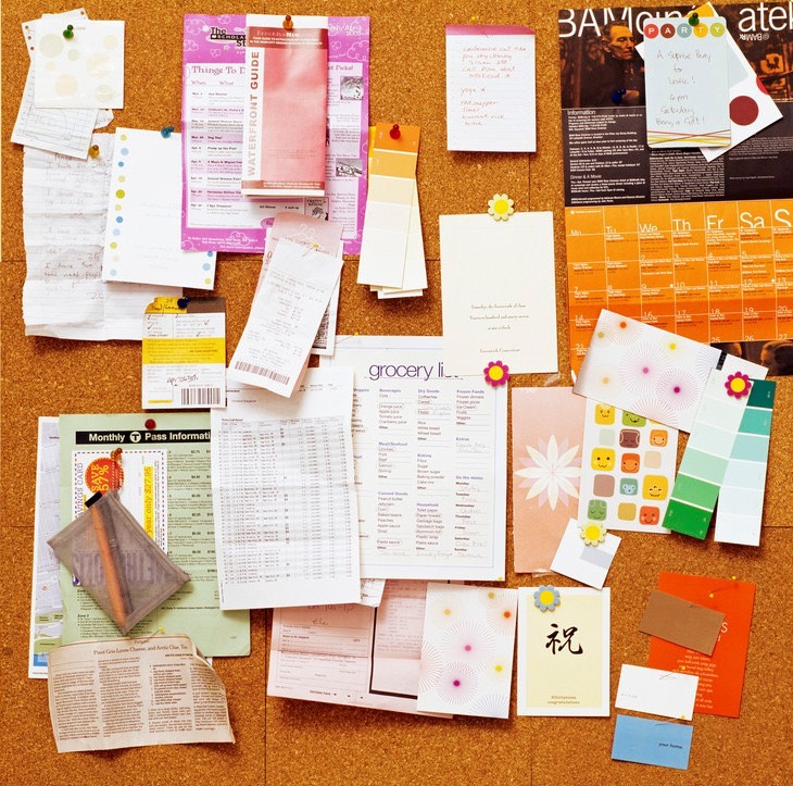 Having loose papers and important notes on the floor or your desk isn't good. You will probably lose them. Hang up some cork board and use some push pins to hang up whatever you want, so they'll be right where you need them and easy to see.