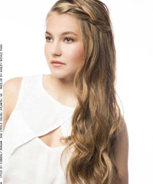 How To Style: 1.Apply a thermal protection spray to hair. 2.Curl sections of hair using alarge curling wand. 3.Braid the front pieces of the hair backwards, join both braids together in the back and secure with an elastic band. If the ends don't reach, secure them with a bobby pin on each si