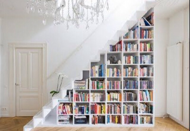 I like the design of under the stairs. Like little book holders.