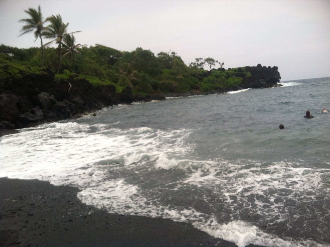 Yes, that is black sand.  Soo cool! Haha