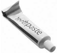 Putting toothpaste on a spot/pimple for a few hours drys it out and it should just fall of