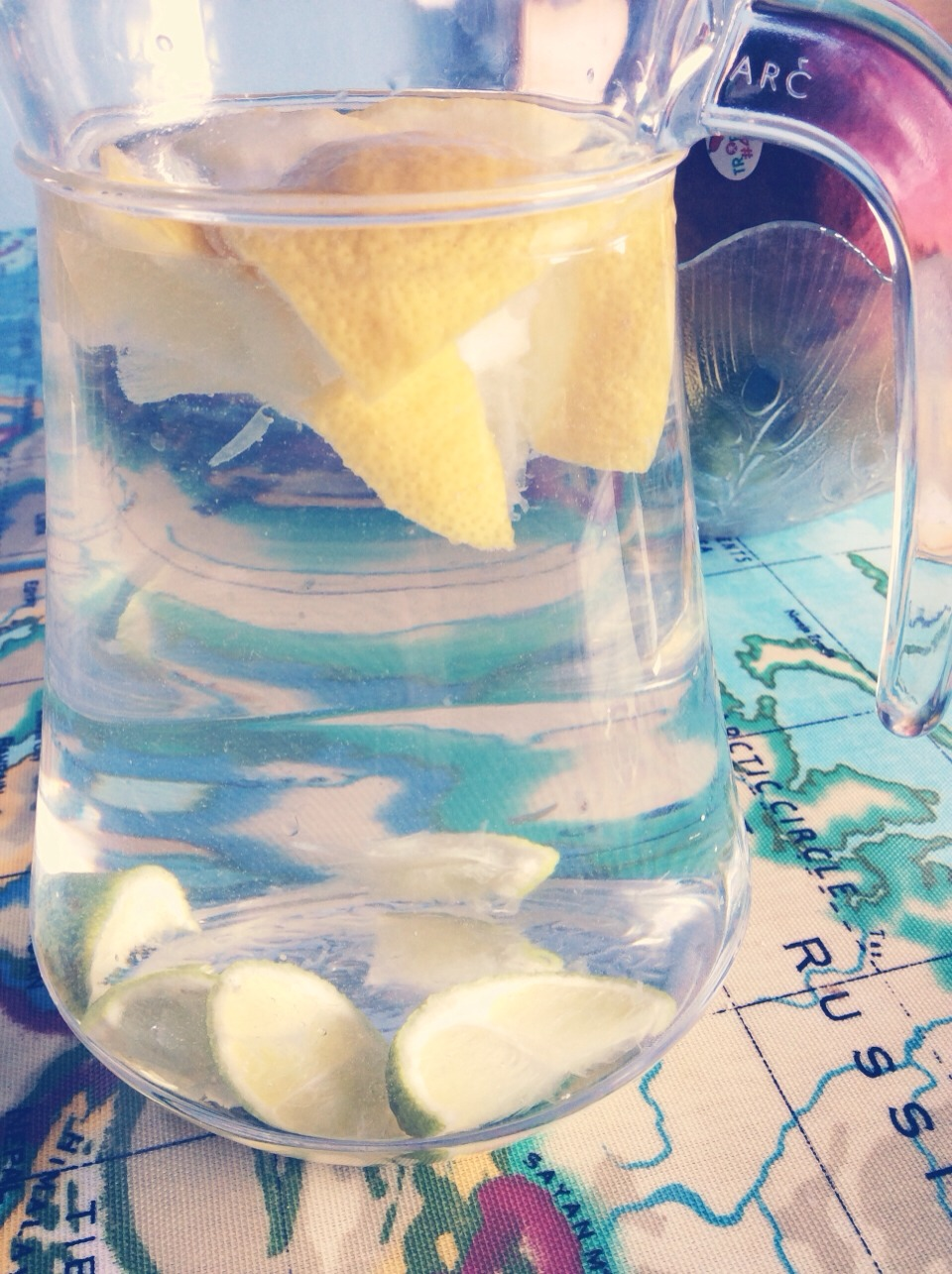 Add 1/2 a jug of water to 1/2 a jug of vodka. Squeeze in some lemons and limes