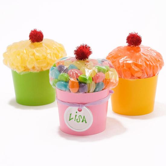 •Candy-Filled Cupcakes   Turn a bag of candy into a cupcake look-alike. Fill a sandwich bag with candy and close tightly. Place the bag with the closing down in a colorful plastic cup. Top with a red pom-pom cherry.