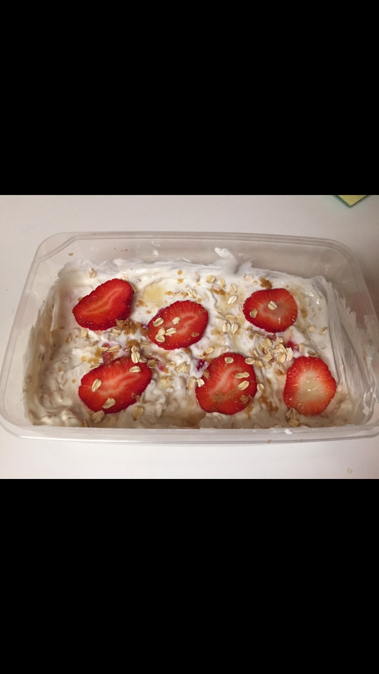 Smooth out the yogurt with the back of your spoon, and add a drizzle of honey, oats, and sugar with some strawberry wheels.