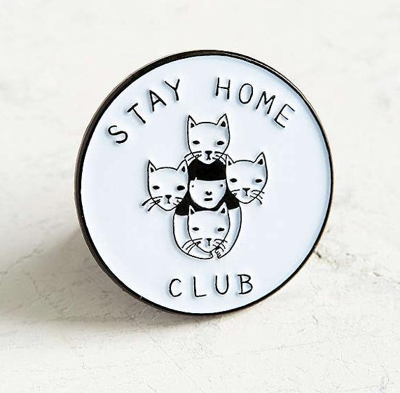 This quaint pin that lets everyone know the only club you'll be found at.