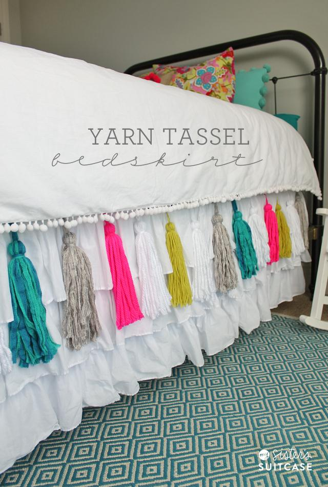 updating a boring bedskirt with vibrant tassels! This project can be made with scrapes, so it's inexpensive, but the results are anything but! Love this idea, I might have to do this to all my bedskirts!