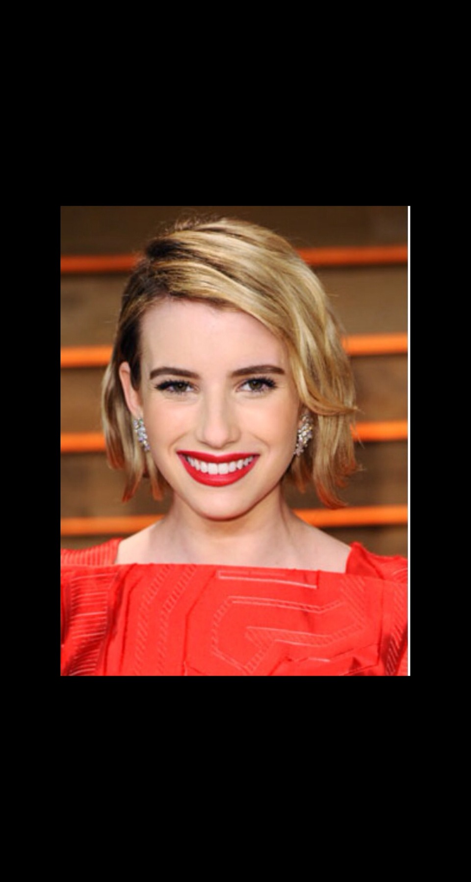 SHORT N' WAVY  Emma Roberts' chic bob got a dose of glam thanks to a deep side part and a wavy, textured look.