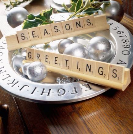 Game greeting  Using Scrabble game tiles, spell out a seasonal message. Place on a platter and accent with ornaments, fresh greens, nuts, berries or ribbons.