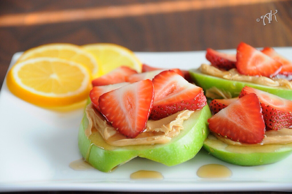 Strawberry apple sandwiches! This is so easy, delicious and surprisingly filling. Simply slice the apple into donut shapes, spread peanut butter all over and top with strawberry's :)