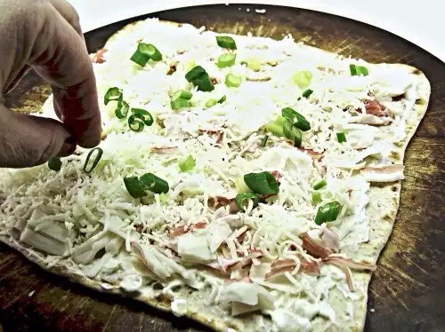 Chop up green onions and put over cheese. Put into your oven for 20-25 min at 400 degrees, or until cheese has melted and edges brown.