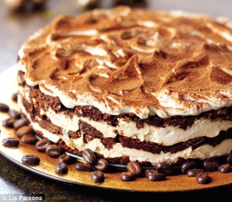 Ingredients:  Cake: *1(18.25 ounce) package moist white cake mix *1 tsp instant coffee powder *1/4 cup coffee *1 tbsp coffee flavored liqueur  Filling: *1(8 ounce) container mascarpone cheese *1/2 cup confectioners sugar *2 tbsp coffee flavored liqueur