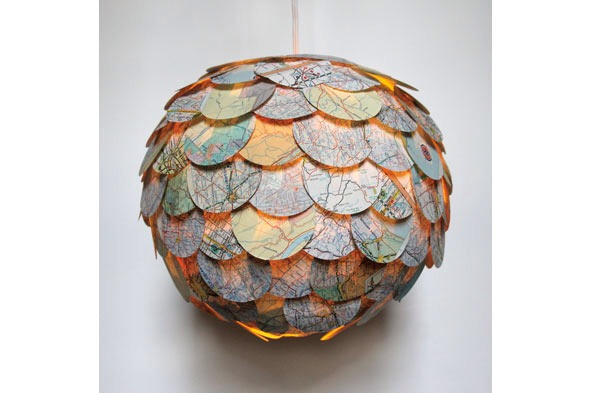 To add a tremendous amount of personality to basic paper lanterns on the cheap, look to map pages. Simply cut the map into circles u you can use a circle cutter, available in the scrapbooking aisle of most craft stores, then glue on rows of map circles, overlapping each for extra texture.