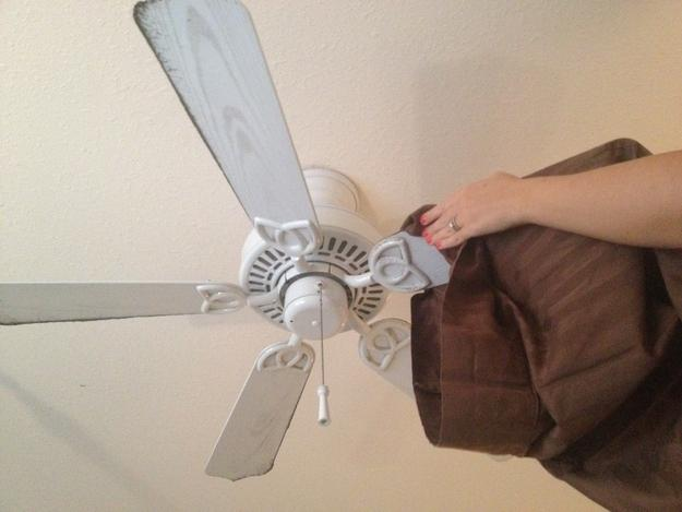 32. Clean the dust off fan blades with an old pillowcase (and a ladder!).