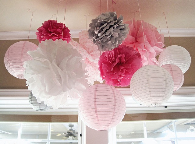 Pompoms are simple Layer tissue paper Fold like you would making a fan Add some string in the middle. The hardest part: gently separate the layers of paper Puff and hang