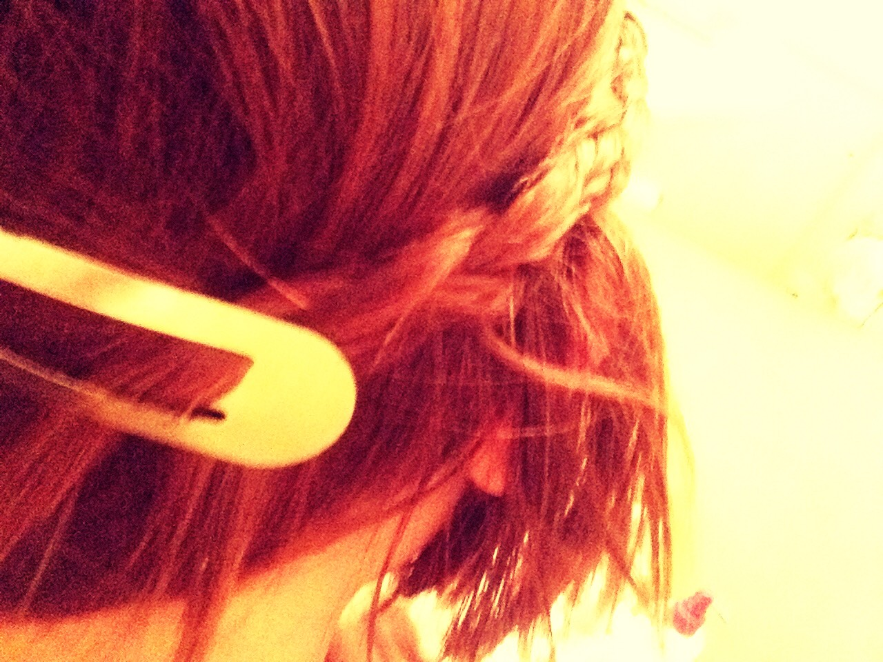 With a clip or bobby pin attach the braid to the back of your head