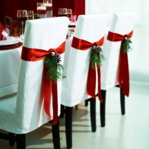 For the holiday dinner, you can cover the chairs and decorate! It looks good and protects chairs from getting dirty at the same time.