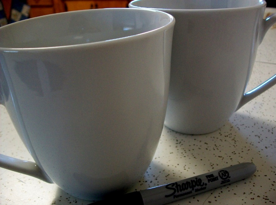 Get a plain ceramic mug and an oil based paint sharpie pen in whatever colors you want.