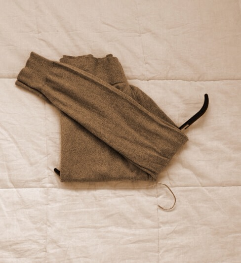 --> Fold the sleeves over the other side.
