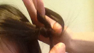 Now it has formed it's own loop And you repeat the same steps until your near the end or your hair strip