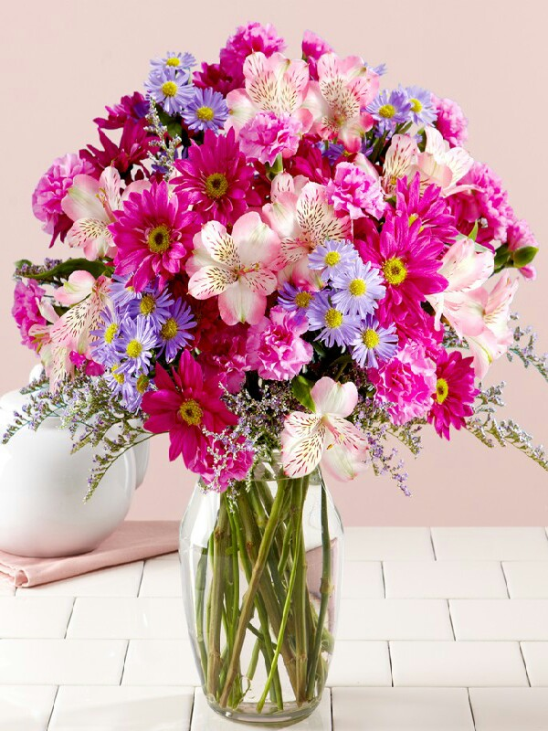 to help keep flowers fresher for longer..add a little sugar to the water.