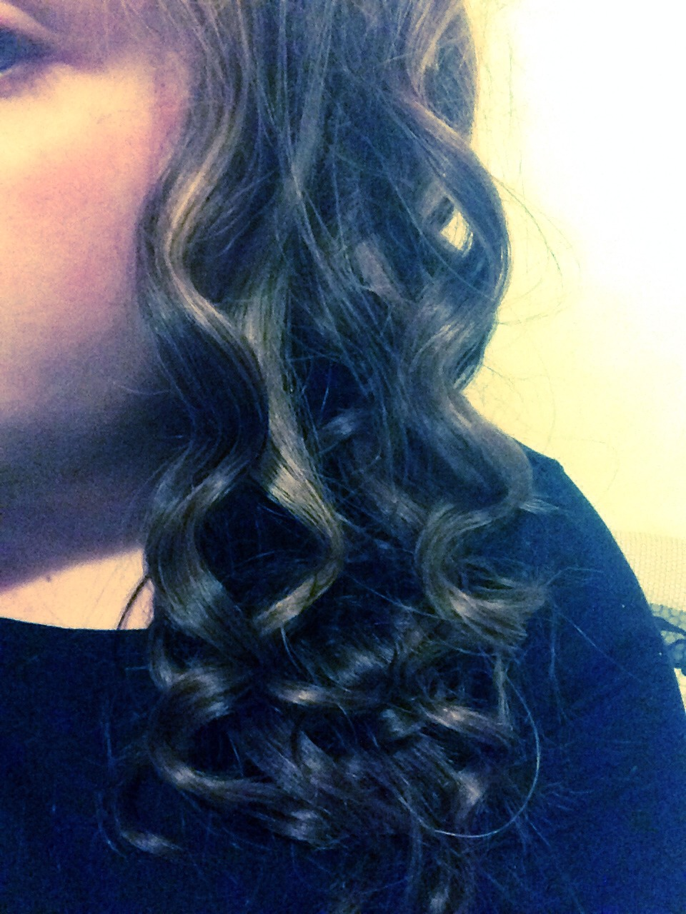 I curl my hair with a curling wand, if you brush your curls out do not hair spray and then brush...