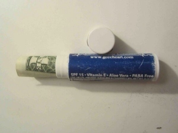 Stash extra cash in an empty lip balm.
