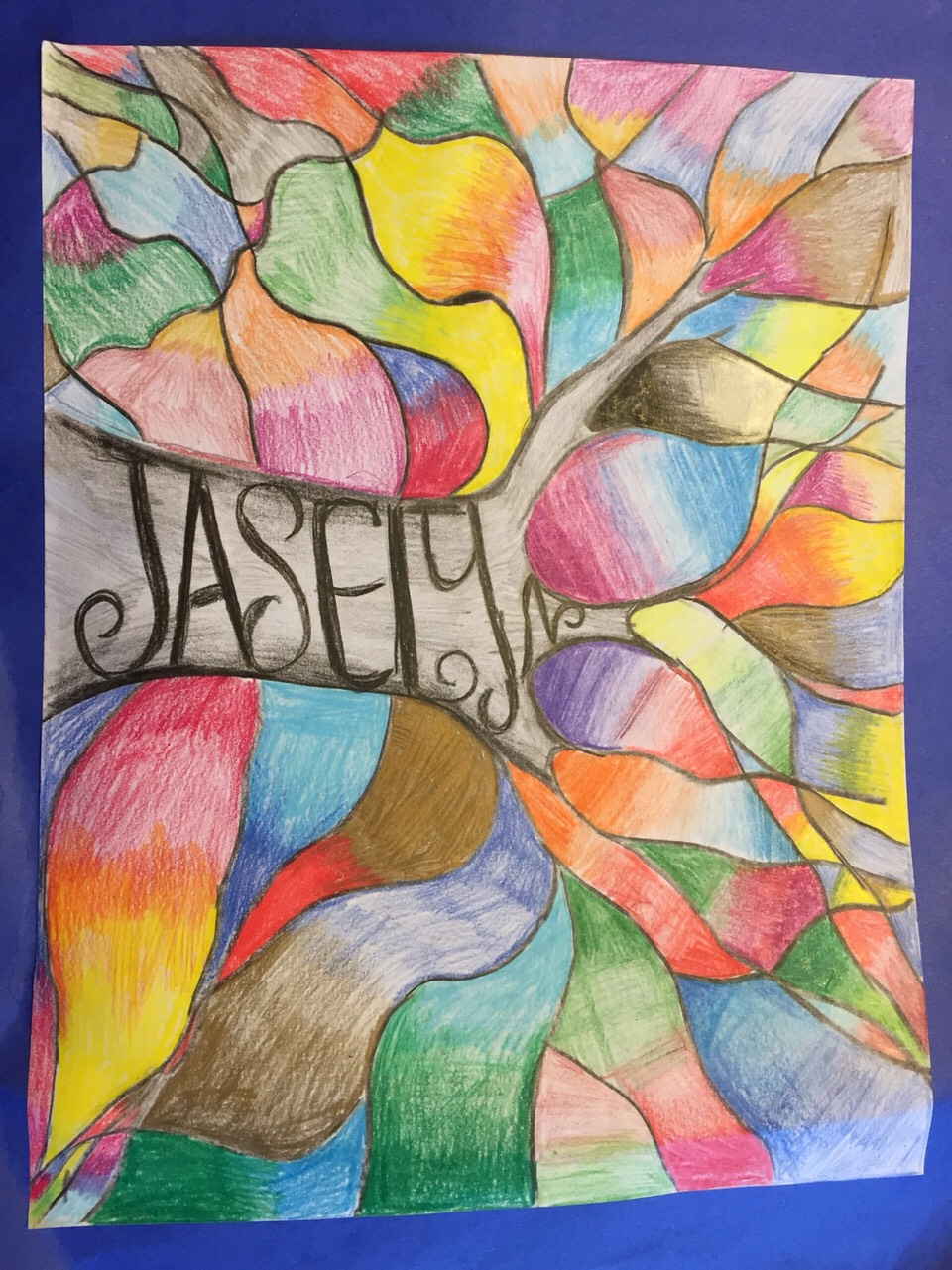 I made this in talented art it is a tree with lots of colors and my name in it it is easy to do.