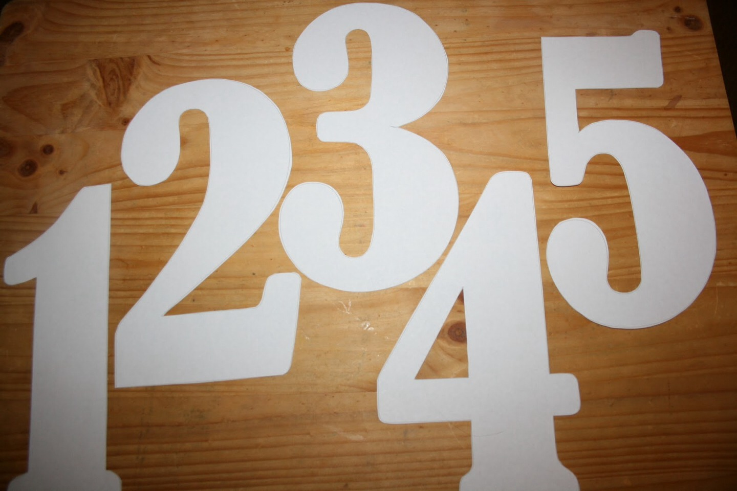 Now take your cut out numbers and glue them to your 2 wooden blocks ! For 1 block u will put the numbers: 0,1,2,6,7,8 ! For the other block you will put the numbers: 0,3,5,9