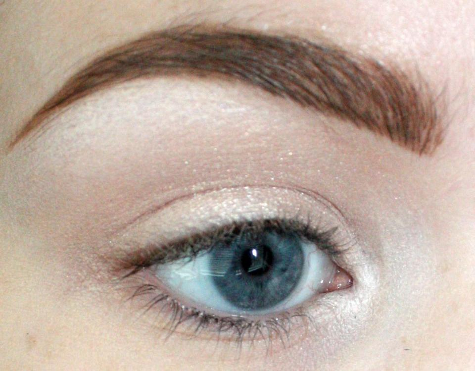 Get your eye primer and base color down. I'm using a MAC paint pot and UD's Bootycall all over the lid. I blended a white eye pencil under the brow bone and in the inner corner to highlight. This helps to bring light into the eye.