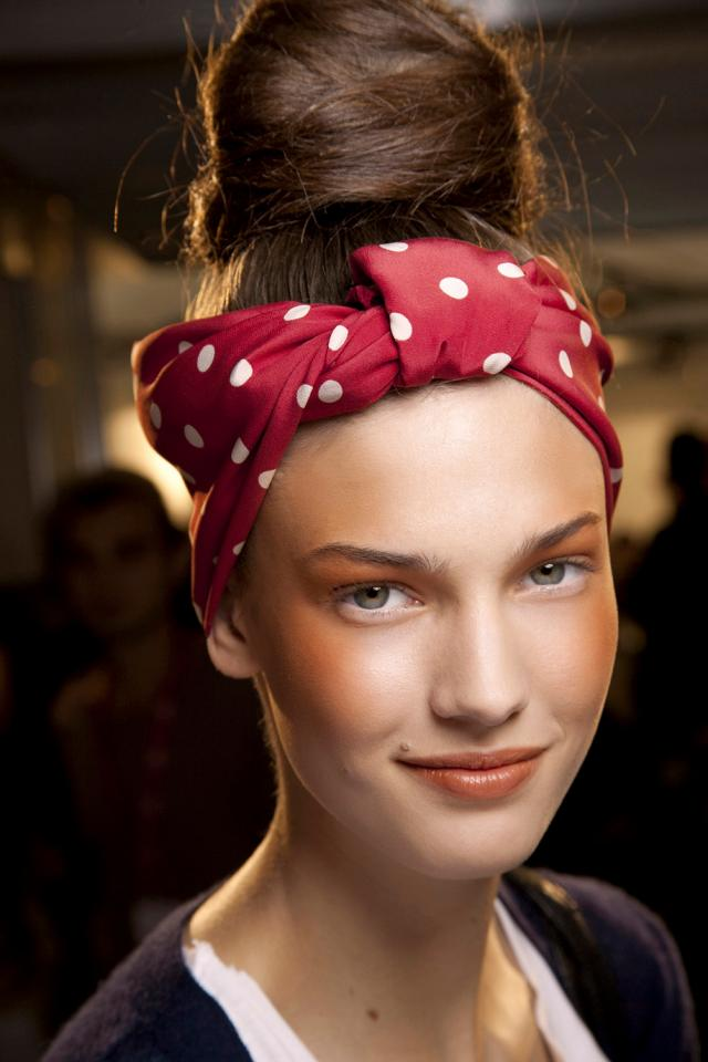 Kick your top knot up a notch by finishing it off with a turban-tied polka dot scarf. This look works with any degree of hair knot, whether it's on the looser, lower side or perched right on top of your head.